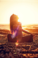 Meditating woman in the bliss of light energy. Available for licensing.