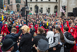 London, UK. 14 October, 2019. Climate activists from Extinction Rebellion stage theatrical mock trials, of the UK's financial sector for the crime of ecocide and of the Government, represented here by Boris Johnson in a blond wig, for 'criminal negligence' in having permitted it, in front of the Bank of England. Roads were blocked around Bank on the eighth day of International Rebellion protests across London.