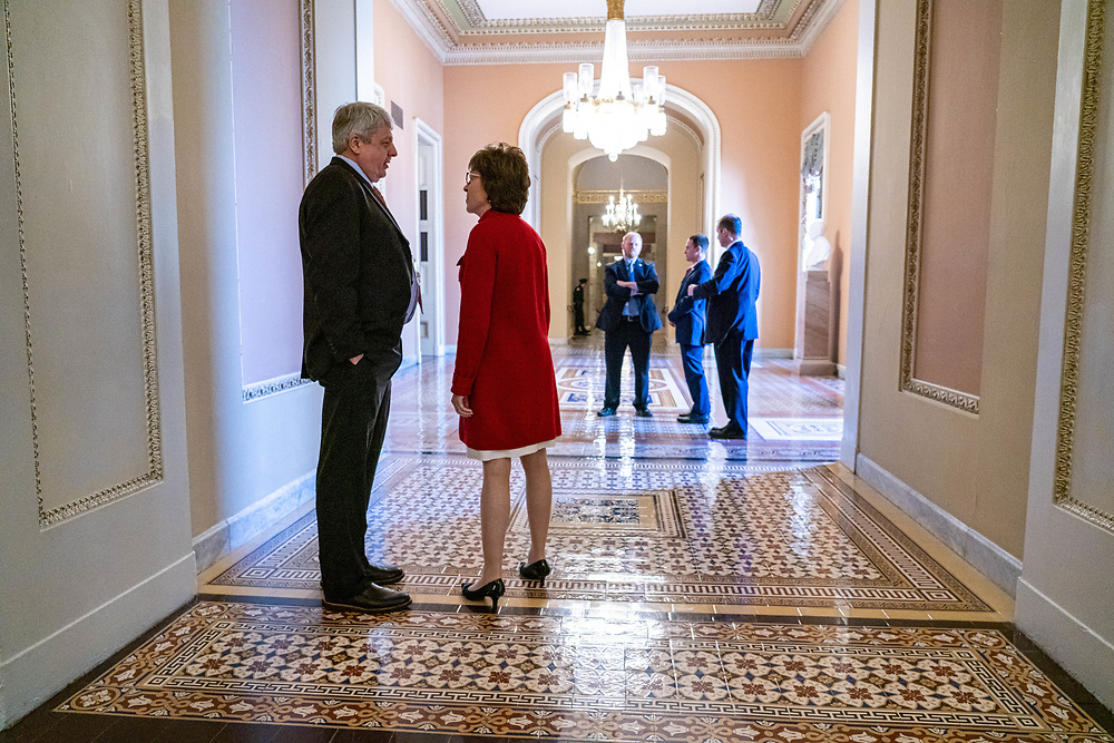 U.S. Sen. Susan Collins (R-ME) talks with New York Times reporter Carl Hulse after Collins walked out front he house floor before going into a Republican luncheon on Capital Hill Dec. 18, 2019, Washington DC. The House votes on impeachment of President Trump who will be the fourth American President facing impeachment. The president is accused of obstruction of Congress and abuse of power.    Photo Credit: Ken Cedeno/Sipa USA