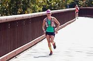 Rosendale, New York  - A runner in the 13.1-mile race crosses the Rosendale Trestle near the end of fhe Shawangunk Ridge Trail Run/Hike on Sept. 16, 2017.