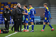 AFC Wimbledon manager Glyn Hodges talking to players during the EFL Sky Bet League 1 match between AFC Wimbledon and Bristol Rovers at Plough Lane, London, United Kingdom on 5 December 2020.