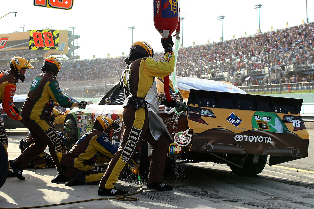 Nov 18, 2012; Homestead, FL, USA; NASCAR Sprint Cup Series driver Kyle Busch comes in for a pit stop during the Ford EcoBoost 400 at Homestead Miami Speedway.