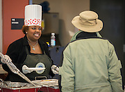 """Transportation East Terminal manager Tesha Foster serves breakfast to bus drivers coming in from their morning routes at the Northwest bus yard as part of the """"Love the Bus"""" month celebration, February 13, 2014."""
