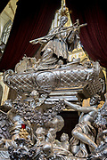The tomb of Johann Nepomuk in St Vitas' Cathedral in Prague Castle, on 18th March, 2018, in Prague, the Czech Republic. The Metropolitan Cathedral of Saints Vitus, Wenceslaus and Adalbert is a Roman Catholic metropolitan cathedral in Prague, the seat of the Archbishop of Prague. Until 1997, the cathedral was dedicated only to Saint Vitus, and is still commonly named only as St. Vitus Cathedral. This cathedral is a prominent example of Gothic architecture and is the largest and most important church in the country. It is located within Hradcany-Prazsky Hrad (Prague Castle) in the Czech capital.