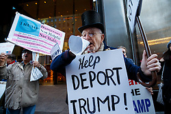© Licensed to London News Pictures. 07/11/2016. New York CIty, USA. Anti-Trump activists campaign outside Trump Tower in New York City on Monday, 7 November, the day before the presidential election day in the United States of America. Photo credit: Tolga Akmen/LNP