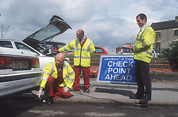 Police checking exhaust emissions on cars,
