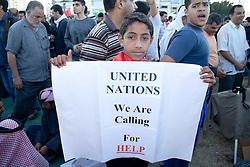 © under license to London News Pictures. 19/02/2011. A boy holds up a sign pleading for help from the United Nations during a protest at the Pearl Roundabout in Manama, Bahrain today (19/02/2011).  Photo credit should read Michael Graae/London News Pictures