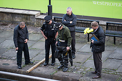 "© Licensed to London News Pictures . 06/10/2013 . Manchester , UK . Specialist police divers examine the find . Police pull a body from The Bridgewater Canal in Manchester , adjacent to the City's "" Gay Village "" . The body was spotted yesterday (6th October) afternoon and a cordon was erected as specialist police divers made the recovery . Photo credit : Joel Goodman/LNP"