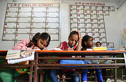 September 7, 2017 - Allahabad, Uttar Pradesh, India - Students attend a class at a government primary school on the eve of World Literacy day in Allahabad on 07-09-2017. September 8 was declared International Literacy Day by UNESCO on November 17, 1965. Its aim is to highlight the importance of literacy to individuals, communities and societies. Celebrations take place in several countries (Credit Image: © Prabhat Kumar Verma/Pacific Press via ZUMA Wire)