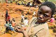 Gold mine in South Kivu, DRC Congo. Very young miner at a processing site where he breaks and grounds down gold ore, mixes it with water,  and extracts the gold. Murale, South Kivu, DRC.  August 2010.<br /> Mineurs très jeune travaille sur un site de traitement proche  d'un mine d'or ou il  ecrase et broie le minerai d'or, le melangant avec d'eau  pour en extraire l or.  Murale, Sud-Kivu, RDC. Aout 2010.