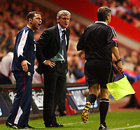 Photo. Daniel Hambury.<br />The Barclays Premiership.<br />Charlton Athletic V Blackburn Rovers. 27/09/2004.<br />Blackburn Rovers' manager Mark HUghes and assistant talk with the linesman