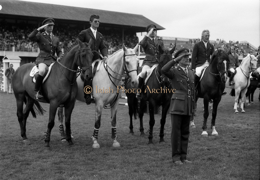 """07/08/1987<br /> 08/07/1987<br /> 07 August 1987<br /> Bank of Irelands Nations Cup for the Aga Khan trophy competition at the Dublin Horse Show at the RDS, Dublin. The winning Irish team  after their victory. Pictured (l-r):  Captain John Ledingham on """"Gabhran""""; Jack Doyle on """"Hardly""""; Commandant Gerry Mullins, on """"Limerick"""" and Eddie Macken on """"Carroll's Flight"""". In front is Col. Ned Campion, Chef d'Equipe ."""