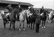 "07/08/1987<br /> 08/07/1987<br /> 07 August 1987<br /> Bank of Irelands Nations Cup for the Aga Khan trophy competition at the Dublin Horse Show at the RDS, Dublin. The winning Irish team  after their victory. Pictured (l-r):  Captain John Ledingham on ""Gabhran""; Jack Doyle on ""Hardly""; Commandant Gerry Mullins, on ""Limerick"" and Eddie Macken on ""Carroll's Flight"". In front is Col. Ned Campion, Chef d'Equipe ."