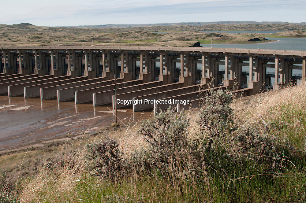 The spillway at the Ft. Peck Dam. The dam is the largest earthern dam in the United States. Completed in 1940 on the Missouri River near Glasgow,  in northern Montana it created Ft. Peck Lake. The dam is 21,026 feet long and 250 feet high. After the spring floods of 2011 the Army Corps of Engineers estimates they need 225 million dollars for repairs but only have 46 million for short tern fixes.