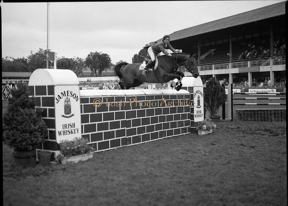 Jameson Whiskey International at the Dublin Horse Show.  (R39).1986..07.08.1986..08.07.1986..7th August 1986..The Jameson Whiskey International at the Dublin Horse Show in the RDS was won by Peter Charles of Great Britain. He rode 'Merrimandias' to victory in the event...Image shows Jay Land (USA),  in the Jameson Whiskey International clearing the wall aboard his mount 'Cold Spring' at the Horse Show. Jameson's, Irish, Whiskey, jameson,