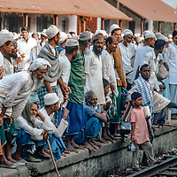 Men wait for a train in Dhaka, Bangladesh, 1977,