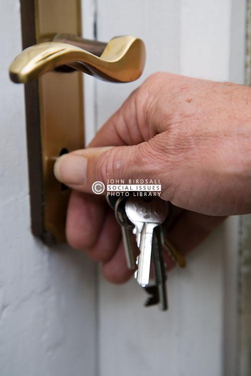 Person unlocking front door,