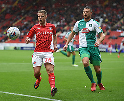 Charlton Athletic's Jamie Ward and Plymouth Argyle's Ryan Edwards battle for the ball