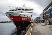 Nordlys Hurtigruten ferry ship in  harbour at Bronnoy, Bronnoysund, Nordland, Norway