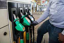 © Licensed to London News Pictures. 30/09/2020. London, UK. Franklyn Owusu at a Shell petrol station in London. Royal Dutch Shell Plc will cut up to 9,000 jobs as part of a major overhaul to shift the oil and gas giant to low-carbon energy. Shell will cut the dividend payments to its shareholder for the first time since World War 2. Photo credit: Dinendra Haria/LNP