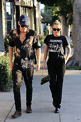 ** PREMIUM EXCLUSIVE RATES APPLY ** Pop star couple Miley Cyrus and Cody Simpson enjoy a stroll in the sun, window shopping for furniture in West Hollywood. Miley rocked a Ramones shirt while Cody is seen in a tiger print shirt. 24 Feb 2020 Pictured: Miley Cyrus, Cody Simpson. Photo credit: Rachpoot/MEGA TheMegaAgency.com +1 888 505 6342
