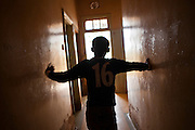 A child stands in a corridor at the AFCIC centre in Thika, Kenya. AFCIC - Action for children in conflict, help children who have been affected by various forms conflict or crisis.