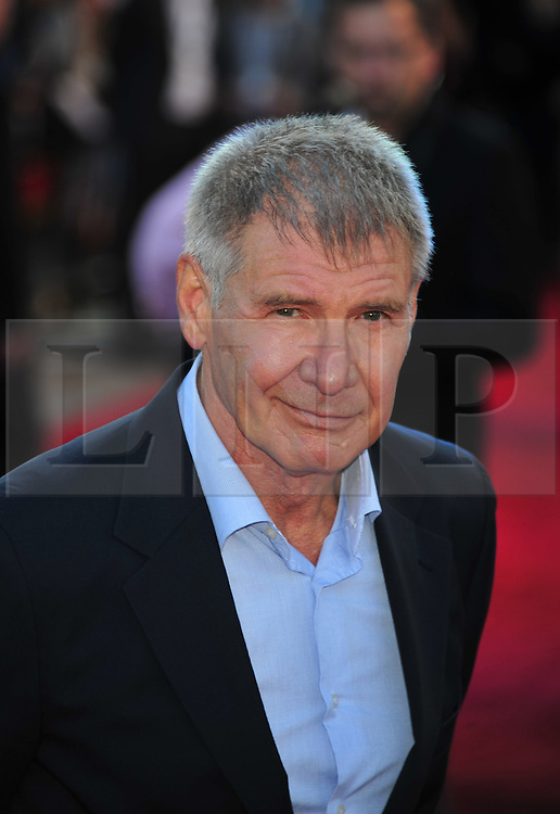 © Licensed to London News Pictures. 11/08/2011. London, England.Harrison Ford attends the U.K premiere of Cowboys and Aliens Starring Harrison Ford and Daniel Craig at the O2 Cineworld London Photo credit : ALAN ROXBOROUGH/LNP