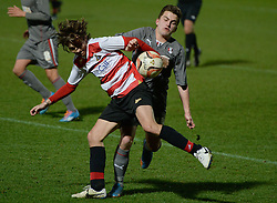 © London News Pictures. 26/02/2014. Doncaster, UK. One Directions Louis Tomlinson (L) makes his debut for Doncastre reserves against Rotherham at the Keepmoat Stadium in Doncaster 26 February 2014 . Photo credit: London News Pictures.