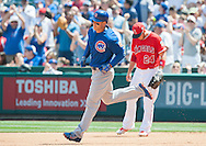 The Cubs' Anthony Rizzo rounds the bases past Angels' first baseman C.J. Cron after a fourth inning home run  during their preseason game at Angel Stadium Sunday.<br /> <br /> <br /> ///ADDITIONAL INFO:   <br /> <br /> angels.0404.kjs  ---  Photo by KEVIN SULLIVAN / Orange County Register  --  4/3/16<br /> <br /> The Los Angeles Angels take on the Chicago Cubs at Angel Stadium during a preseason game at Angel Stadium Sunday.<br /> <br /> <br />  4/3/16