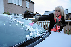 © Licensed to London News Pictures. 19/01/2015<br />Cleaning ice off the car.<br />A very cold morning St Pauls Cray,Orpington,Kent. today (19.01.2015)<br />Weather warning has been issued across most of the uk as temperatures dropped overnight to -11c in parts.<br /><br />(Byline:Grant Falvey/LNP)
