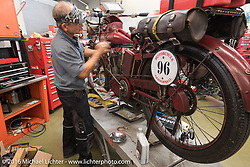 Doug Jones wrenching on his 1914 Indian Model 260 Standard at Harley-Davidson of Bloomington where they opened the shop to work on all of the old bikes during the Motorcycle Cannonball Race of the Century. Stage-4 from Chillicothe, OH to Bloomington, IN. USA. Tuesday September 13, 2016. Photography ©2016 Michael Lichter.
