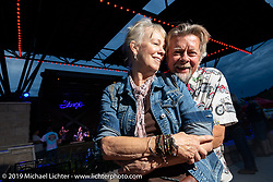 Two-Wheelers' Arlin Fatland and Donna Maupin check out the Britnee Kellogg band playing the stage at the Harley-Davidson Rally Point on the corner of Main and Harley-Davidson Way during the Sturgis Black Hills Motorcycle Rally. SD, USA. Saturday, August 10, 2019. Photography ©2019 Michael Lichter.