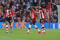 Football - 2019 / 2020 Premier League - Southampton vs. Newcastle United<br /> <br /> Southampton's Danny Ings consoles Southampton's Moussa Djenepo after the winger was given a red card during the Premier League match at St Mary's Stadium Southampton <br /> <br /> COLORSPORT/SHAUN BOGGUST