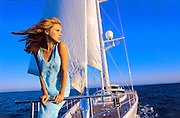 Sunshine, a guest, enjoys the wind on the bow off Cabo San Lucas, Mexico