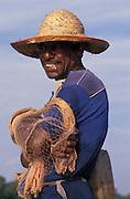 Sri Lanka. A fisherman at Negombo smoking a beedi.