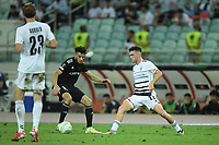Abdellah Zoubir (10) fights for the ball with Sergio Lopez (22) of FC Basel  during the UEFA Europa Conference League group H match between Qarabag FK and FC Basel at  on September 16, 2021 in Baku, Azerbaijan.