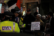 London 04/01/09: Protests outside the Israeli Embassy in London UK: Police argue with a protester