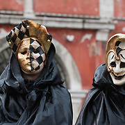 VENICE, ITALY - FEBRUARY 20: Two people wearing Carnival costumes and masks pose in Cannaregio on February 20, 2011 in Venice, Italy. The Venice Carnival, one ofthe largest and most important in Italy, attracts thousands of people from around the world each year. The theme for this year's carnival is Ottocento amd Sissi, a nineteenth century evocation, andwill runfrom February 19 till March 8.