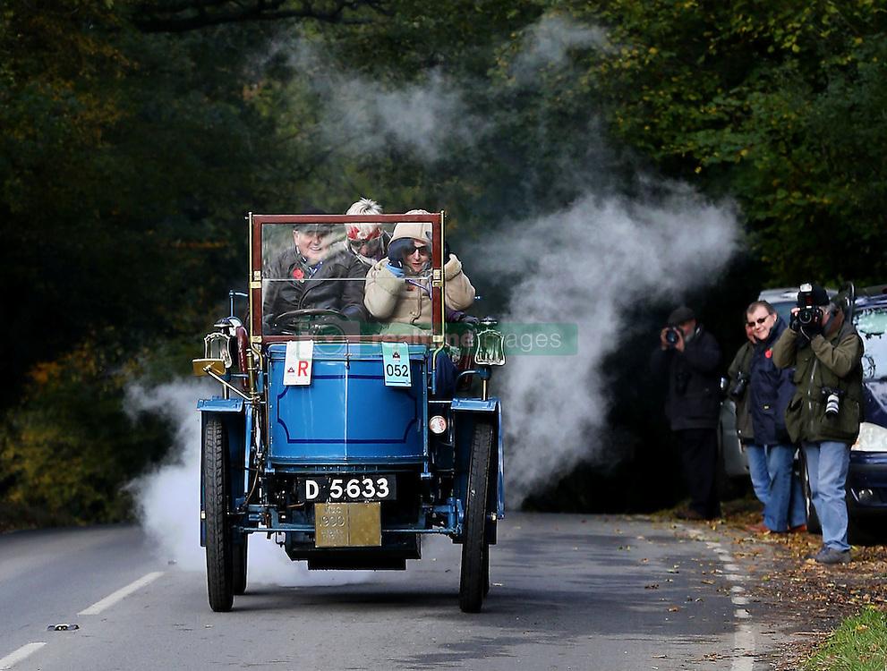 Participants in the Bonhams London to Brighton Veteran Car Run head up Holmsted Hill near Crawley, Sussex.