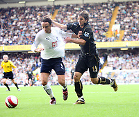 Photo: Chris Ratcliffe.<br /> Tottenham Hotspur v Portsmouth. The Barclays Premiership. 01/10/2006.<br /> Niko Kranjcar (R) of Portsmouth clashes with Dimitar Berbatov of Spurs.
