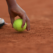 A ball boy collects the ball during the second round of the French Open Tennis Tournament in Paris, France on Thursday, May 28, 2009. Photo Tim Clayton.