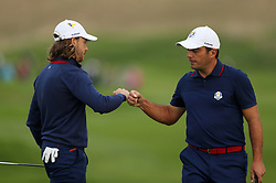 Team Europe's Tommy Fleetwood and Team Europe's Francesco Molinari bump fists during the Fourballs match on day one of the Ryder Cup at Le Golf National, Saint-Quentin-en-Yvelines, Paris.