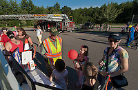 David Stamps from Lakes Region Community Emergency Response Team chats with Melany, Julie, Christopher and Suzy Campbell during Laconia's National Night Out at Woodland Heights School Tuesday evening.  (Karen Bobotas/for the Laconia Daily Sun)