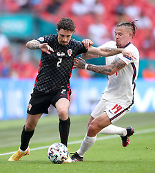 Croatia's Sime Vrsaljko (left) and England's Kalvin Phillips battle for the ball during the UEFA Euro 2020 Group D match at Wembley Stadium, London. Picture date: Sunday June 13, 2021.