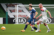 Cedric Soares of Arsenal with Dundalk's  Chris Shields during the Europa League Group B match between Dundalk and Arsenal at Aviva Stadium, Dublin, Republic of Ireland on 10 December 2020.