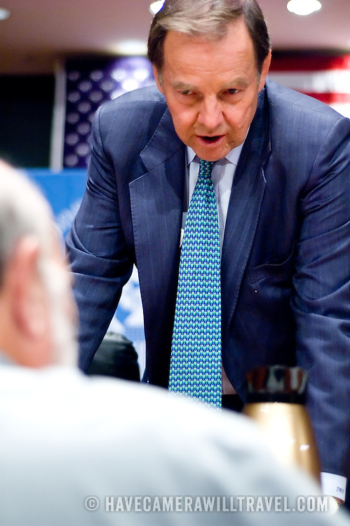 """Thomas Kean speaks with a reporter during a break between panels. The 9/11 Commission's 12th public hearing on """"The 9/11 Plot"""" and """"National Crisis Management"""" was held June 16-17, 2004, in Washington, DC."""