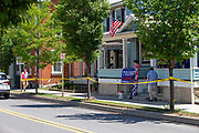 Mifflinburg resident Vincent Yonai (R) used yellow caution tape to block off the sidewalk on half a block of Chestnut Street during the Mifflinburg Pride Event. As a pedestrian entered the taped-off area, Yonai retrieved a bat and went toward the man in a threatening manner and demanded that he get off of the sidewalk. Yonai was eventually taken away in handcuffs by Mifflinburg Police.