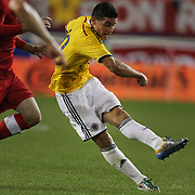 James Rodriguez, Colombia, shoots to score the winning goal during the Columbia Vs Canada friendly international football match at Red Bull Arena, Harrison, New Jersey. USA. 14th October 2014. Photo Tim Clayton