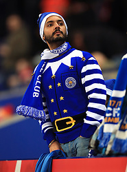 A Leicester City fan in the stands show his support during the Premier League match at the King Power Stadium, Leicester.