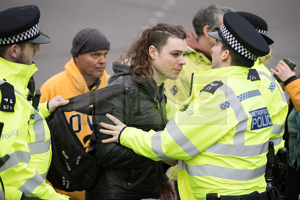 "© Licensed to London News Pictures. 11/03/2018. London, UK. A man is removed from the demonstration by police . Alt right group Generation Identity and other far-right groups hold a demonstration at Speakers' Corner in Hyde Park , opposed by antifascists . Generation Identity supporters Martin Sellner and Brittany Pettibone were due to speak at the demo but were arrested and detained by police when they arrived in the UK , also forcing them to cancel an appearance at a UKIP "" Young Independence "" youth event , which in turn was reportedly cancelled amid security concerns . Photo credit: Joel Goodman/LNP"